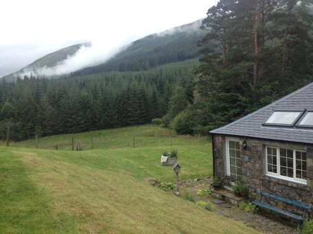 Mountains, forest, and the back of the cottage we stayed in near Fort William, Scotland.